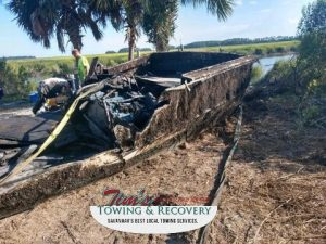 Boat on shore after heavy wrecker recovery