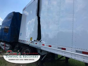 Damaged container I-95 before Commercial Towing- Service Performs Recovery