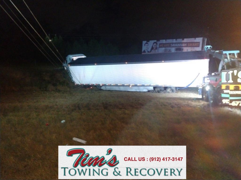 tractor trailer in ditch in need of heavy truck towing