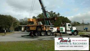 Crane towing company at Tim's Towing working on Broderson Crane