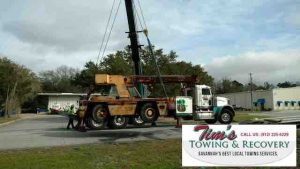 The crane in the air by Crane Towing Company